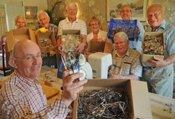 Members of Rotary Club of York Ainsty sorting specs.